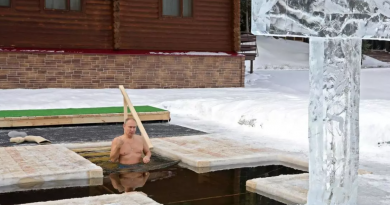 Watch genuflecting Putin take a plunge: Russian president among thousands of Orthodox Christians braving icy dip in freezing waters to mark Epiphany